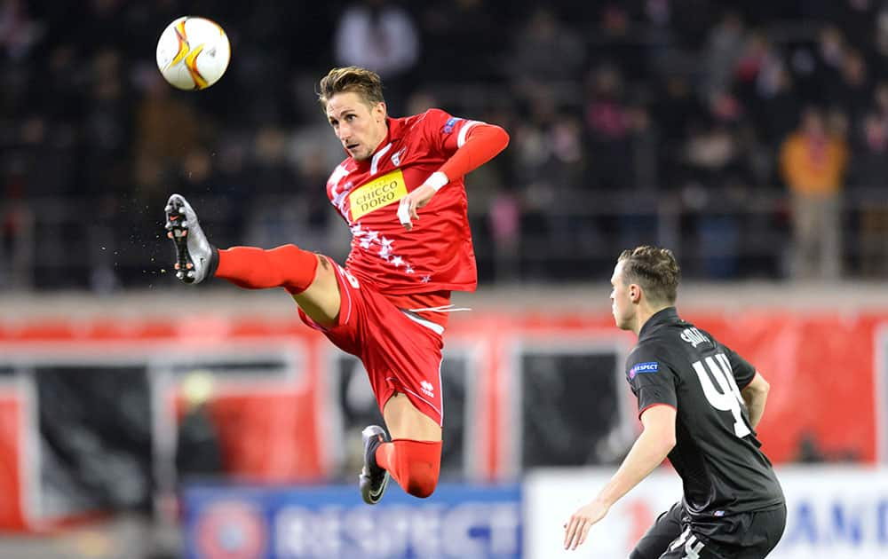 Sion's Vincent Ruefli, left, tries to control the ball as Liverpool's Bradley Smith, right, looks on during the Europa League group B soccer match between FC Sion and FC Liverpool at the Tourbillon stadium in Sion, Switzerland.