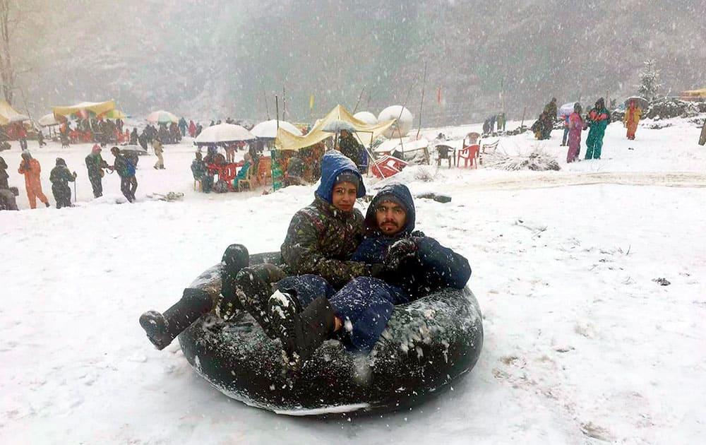 Tourists enjoying snow at Manali in Himachal Pradesh
