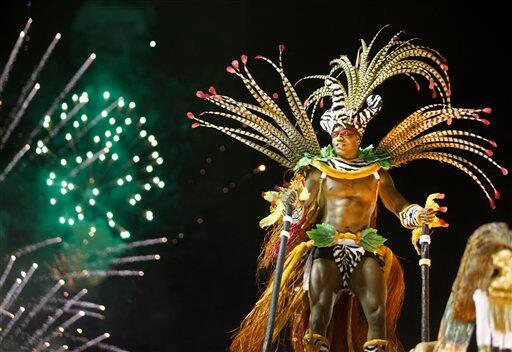A dancer from the Imperatriz Leopoldinense samba school parades during Carnival celebrations at the Sambadrome in Rio de Janeiro, Brazil.