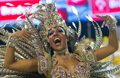 A dancer performs during the parade of Vila Maria samba school in Sao Paulo, Brazil.