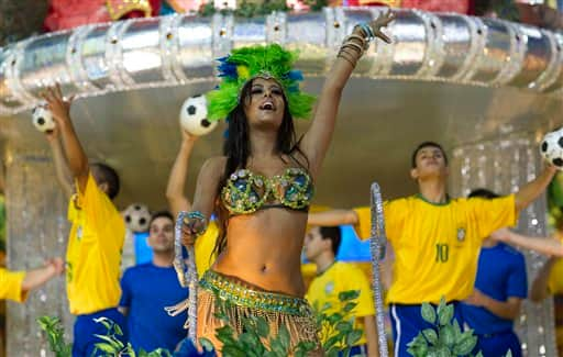 Lingerie model Larissa Riquelme of Paraguay waves from the top of a Vila Maria samba school float during carnival celebrations in Sao Paulo, Brazil.