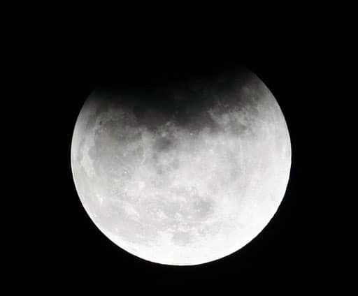 The Earth casts a shadow over the moon in a partial lunar eclipse that was observed Saturday, June 26, 2010 in Manila, Philippines.