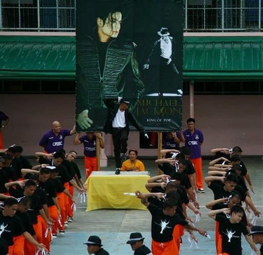 Inmates perform a Michael Jackson song to pay tribute to the King of Pop on his first death anniversary Saturday June 26, 2010 at the Cebu jail in Cebu city, central Philippines.