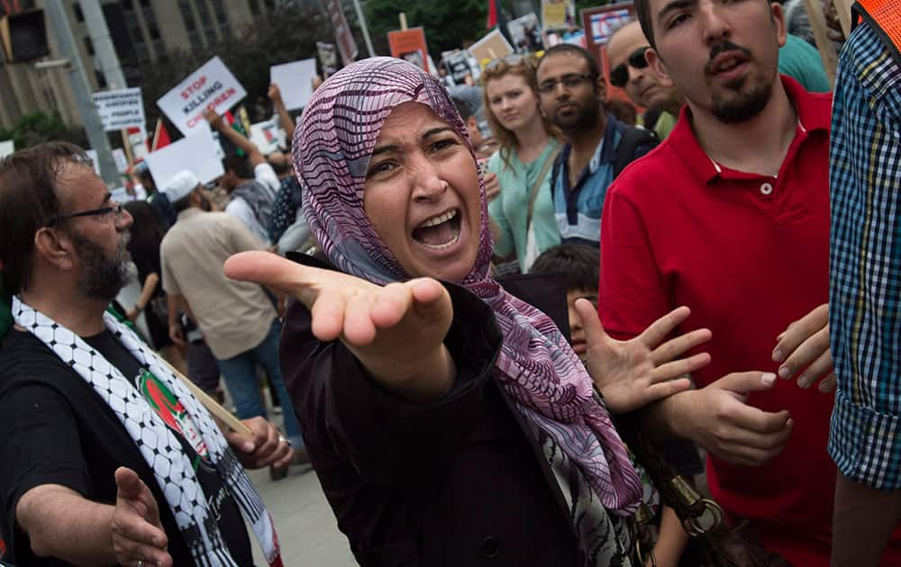A Palestinian supporter yells at opposing Israeli supporters as hundreds protest the war between Israel and Hamas members in the Gaza Strip in Toronto.