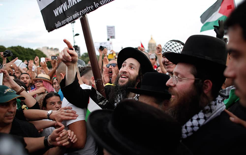 Members of the Ultra-Orthodox Jewish Neturei Karta, a group that opposes Zionism and the Israeli state, protest against the Israeli army`s bombings in the Gaza strip in Paris, France.