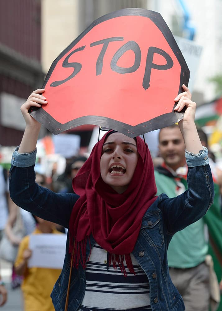 Demonstrators protest in Ottawa against the ongoing war between Israel and Hamas militants who control Gaza, calling for Canada to defend human rights for Palestinians.