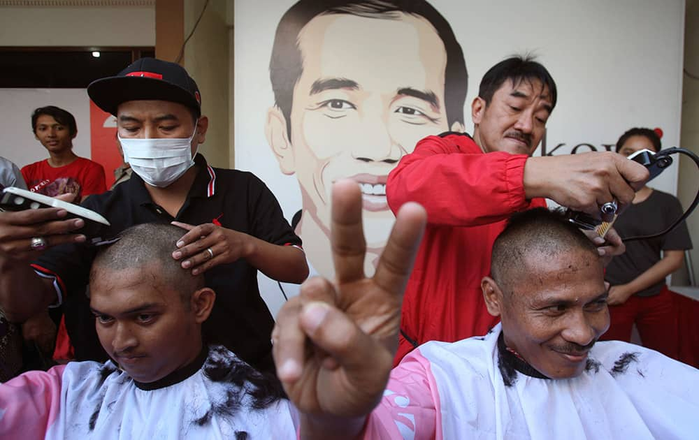 Supporters of Indonesian presidential candidate Joko Widodo cut their hair to celebrate in Surabaya, East Java, Indonesia. Jakarta governor Joko Widodo, who captured the hearts of millions of Indonesians with his common man image, won the country`s presidential election with 53 percent of the vote.