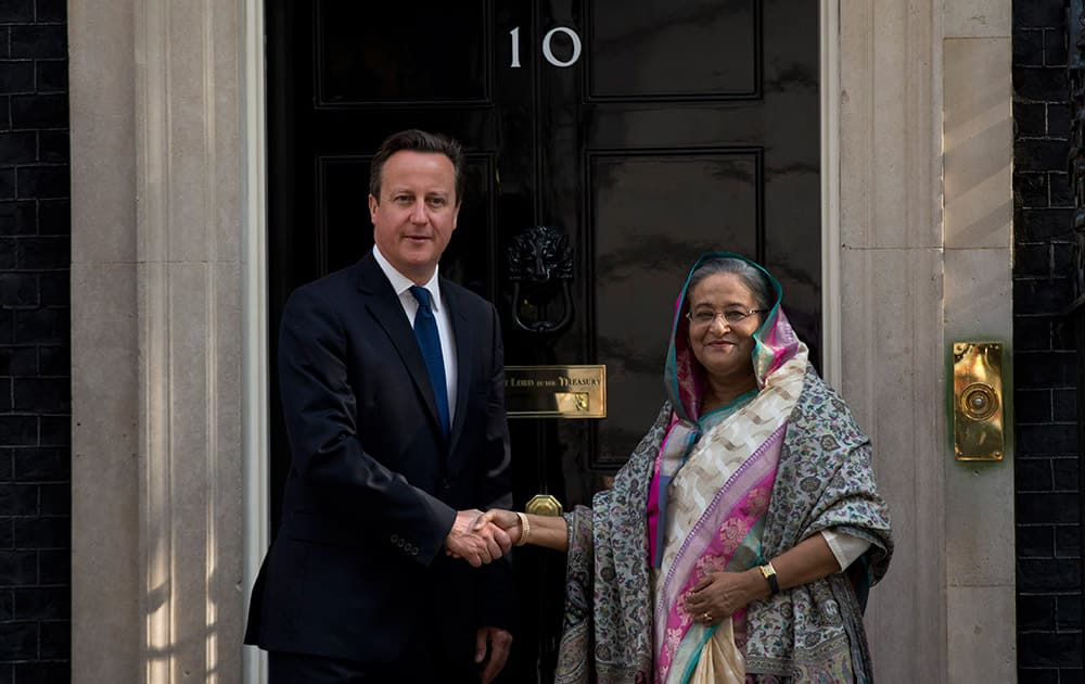 British Prime Minister David Cameron, left, and Bangladesh Prime Minister Sheikh Hasina pose for photographers outside 10 Downing Street, before the start of their meeting in London.