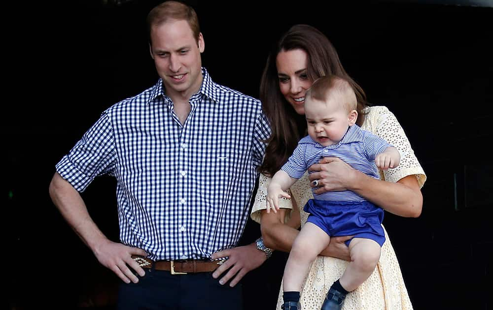 File Photo- Britain`s Prince William, Kate Duchess of Cambridge and Prince George. Today is baby Prince George`s first birthday.