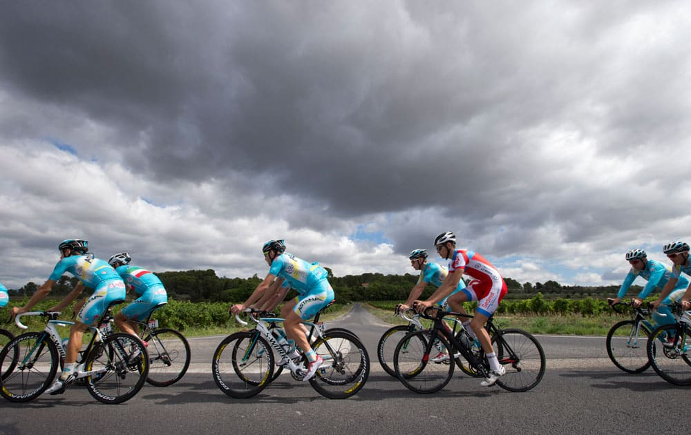 Team Astana with overall leader Italy`s Vincenzo Nibali, second left with the Italian flag on his jersey, trains on the second rest day of the Tour de France cycling race in Lignan-sur-Orb, southern France.
