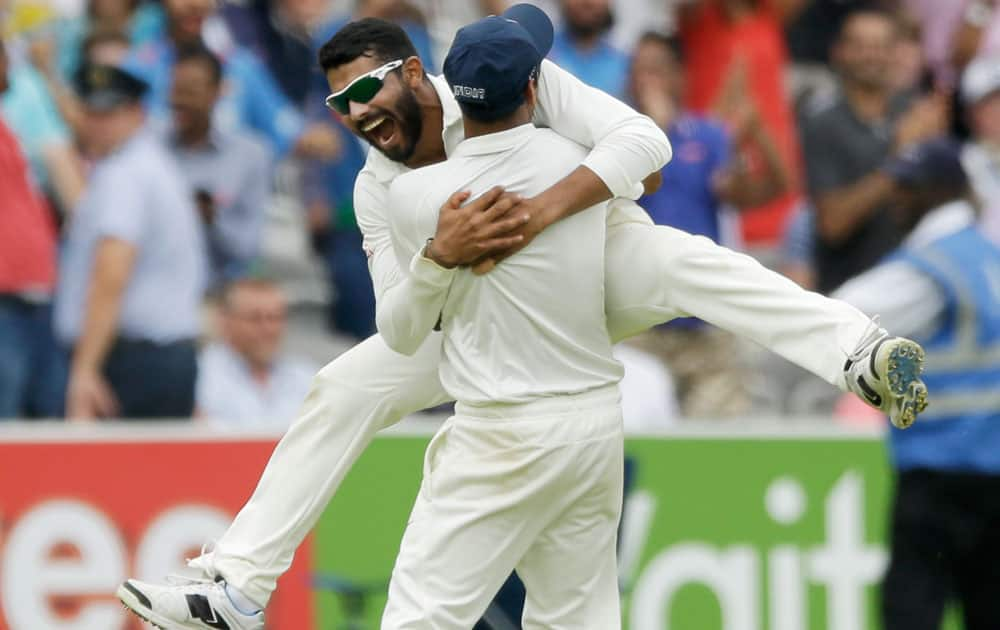 India`s Ravindra Jadeja is held up by a teammate as he celebrates after running out England`s James Anderson to win the test match on the fifth day of the second cricket test match between England and India at Lord`s cricket ground in London. India won the match by 95 runs. The International Cricket Commission (ICC) has set next Tuesday as the date for a disciplinary hearing against James Anderson for shoving India`s Ravindra Jadeja during the first test.