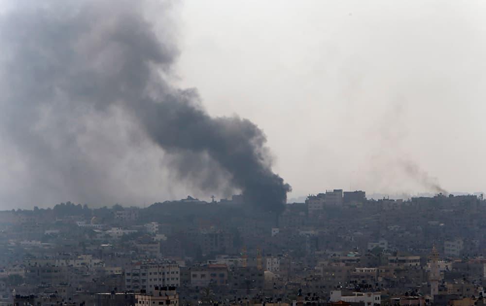 Smoke from Israeli strikes rises over Gaza City , northern Gaza Strip.