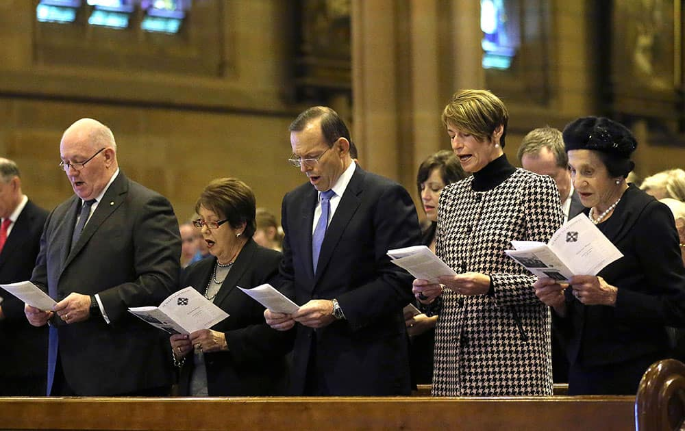From right: New South Wales Governor Marie Bashir, Margie Abbott, Australia`s Prime Minister Tony Abbott, Lady Lynne Cosgrove and Governor General Sir Peter Cosgrove sing a hymn during a Mass at St. Mary`s Cathedral commemorating victims of Malaysia Airlines Flight 17, in Sydney.