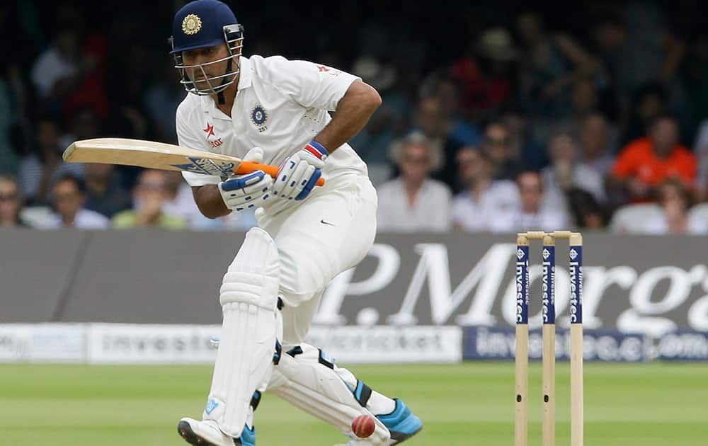 India`s MS Dhoni plays a shot off the bowling of England`s James Anderson during the fourth day of the second test match between England and India at Lord`s cricket ground in London.