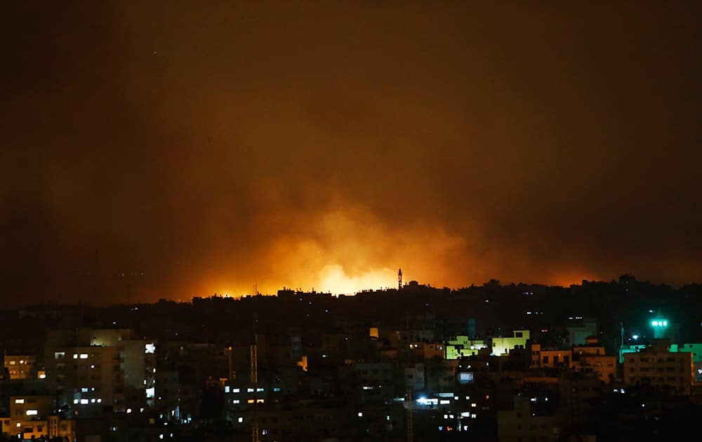 Smoke from flares fired by Israeli forces rise in the sky in Gaza City, in the northern Gaza Strip.