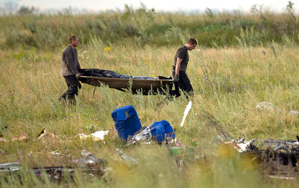 Emergency workers carry the body of a victim at the crash site of Malaysia Airlines Flight 17 near the village of Hrabove, eastern Ukraine.