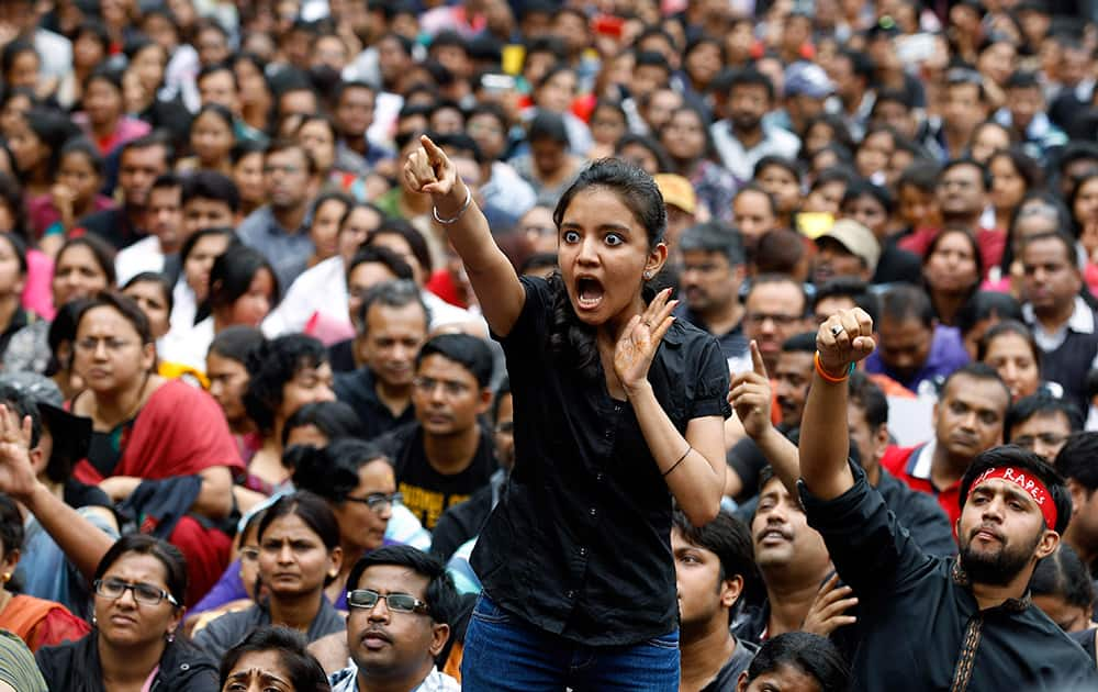 An angry protester points her finger towards the Bangalore police chief during a protest against alleged police inaction after a six-year-old was raped at a school, in Bangalore.