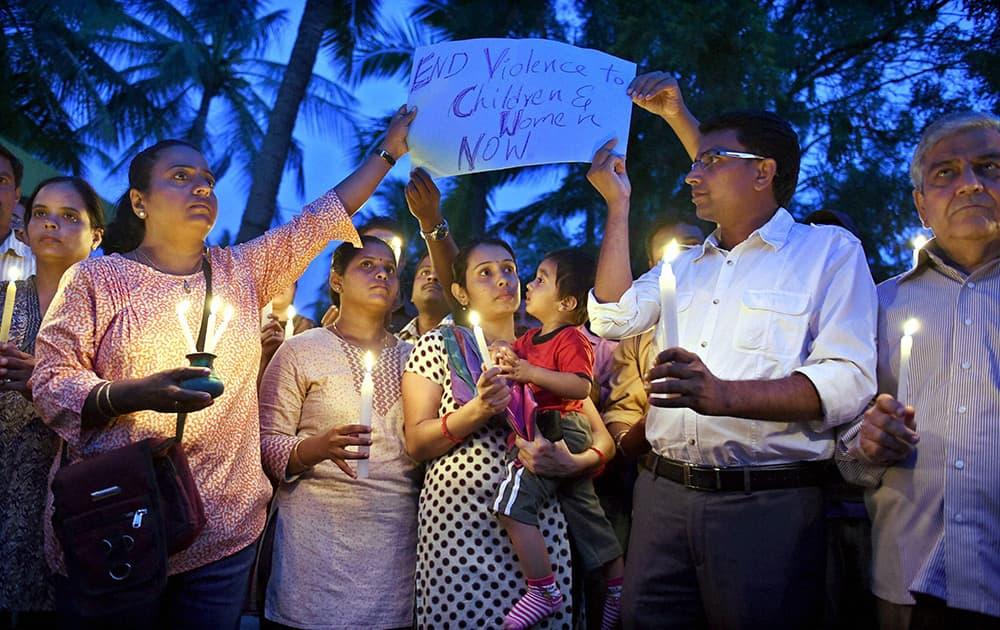 Parents of Vibgyor School kids hold a candle march at a school where a 6-year-girl was raped last week, in Bengaluru.