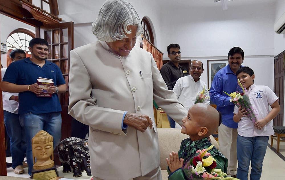 Former President APJ Abdul Kalam with super kid Kautilya Pandit at his residence in New Delhi.