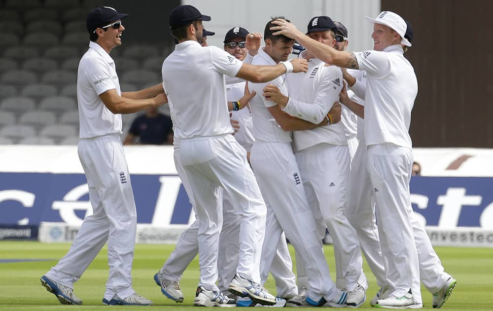 England`s James Anderson celebrates the wicket of India`s Shikhar Dhawan during the first day of the second test match between England and India at Lord`s cricket ground in London.