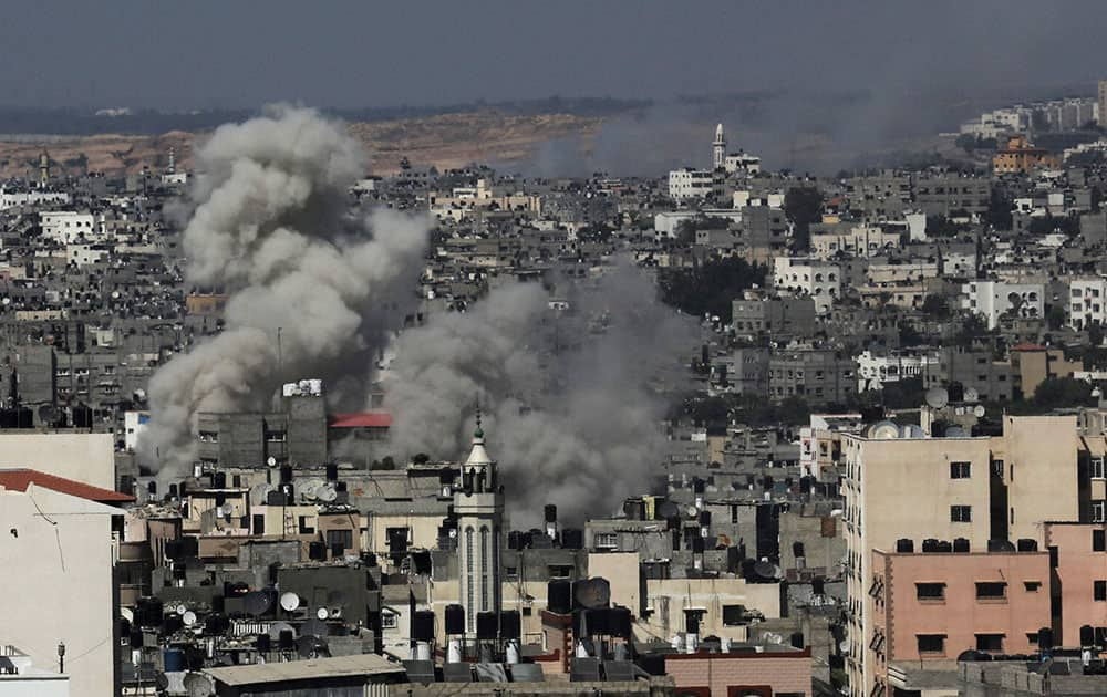 Smoke rises after Israeli missile strikes hit the northern Gaza Strip.