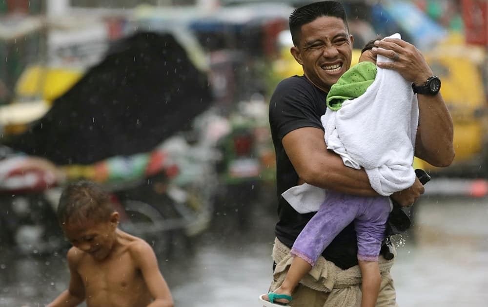 Residents at the slum community of Baseco evacuate to safer grounds at the onslaught of Typhoon Rammasun (locally known as Glenda) which battered Manila.