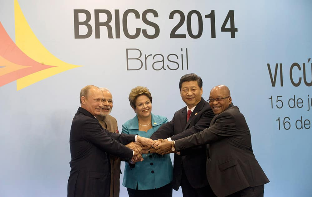 Leaders of the BRICS nations, from left, Russia`s President Vladimir Putin, India`s Prime Minister Narendra Modi, Brazil`s President Dilma Rousseff, China`s President Xi Jinping and South Africa`s President Jacob Zuma, pose for a group photo during the BRICS summit in Fortaleza, Brazil.