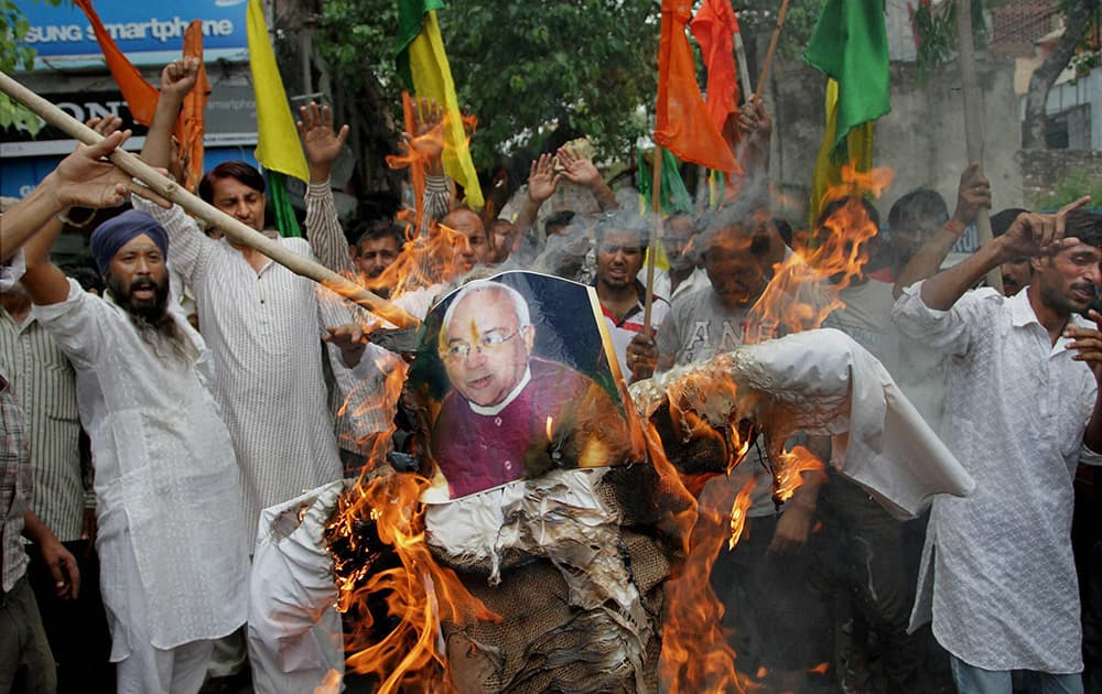 Activists of Shiv Sena and Dogra front burn an effigy of Ved Partap Vaidik during a protest in Jammu.