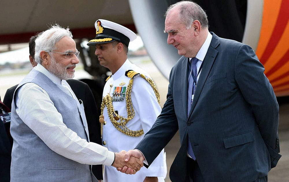 Prime Minister Narendra Modi being welcomed at the airport by chief coordinator of BRICS and the Brazilian Foreign Ministry Louise Lopes at Fortaleza in Brazil.
