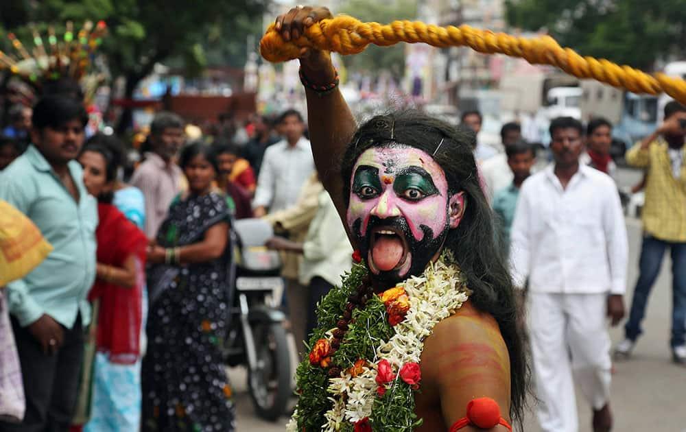 Pothuraju, a devotee of Hindu goddess Kali performs a ritual at the Bonalu festival procession at Secunderabad Ujjaini Mahakali temple in Hyderabad.