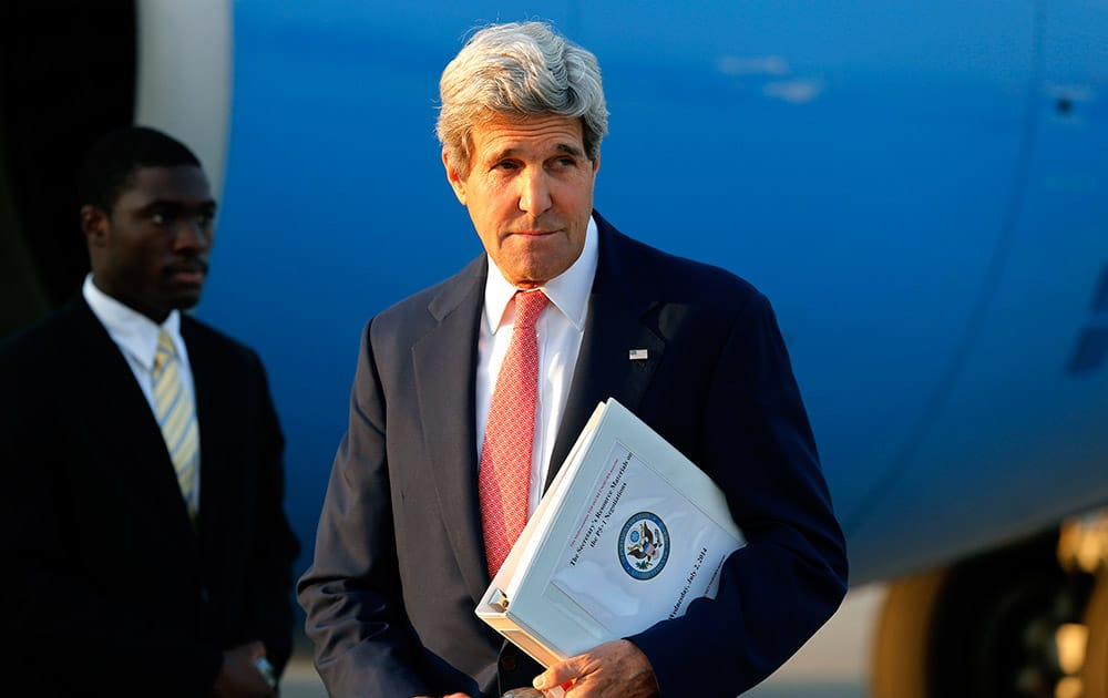 US Secretary of State John Kerry leaves his plane at Vienna International Airport as he arrives for talks with foreign ministers from the six powers negotiating with Tehran on its nuclear program in Vienna.