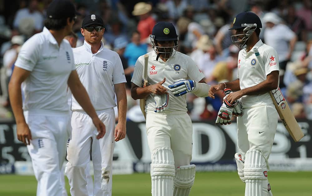 India`s Bhuvneshwar Kumar, right, Mohammed Shami, 2nd right, leave the pitch for tea interval alongside England`s Ian Bell, 2nd left, during day two of the first Test between England and India at Trent Bridge cricket ground, Nottingham.