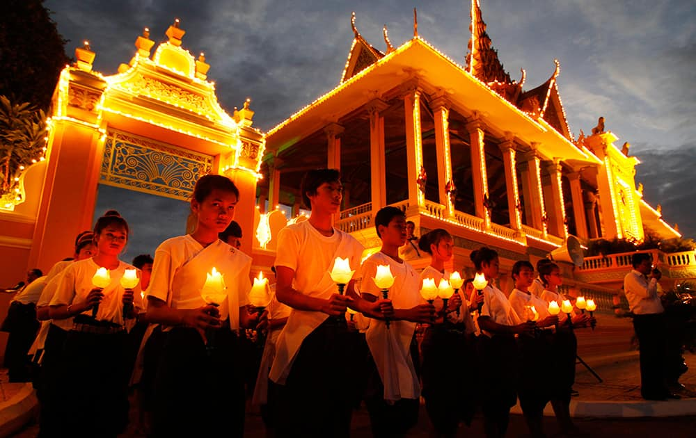 Cambodian dancers perform a candle light dance during the three-day Buddhist ceremony for late former King Norodom Sihanouk in front of the Royal Palace, in Phnom Penh, Cambodia.