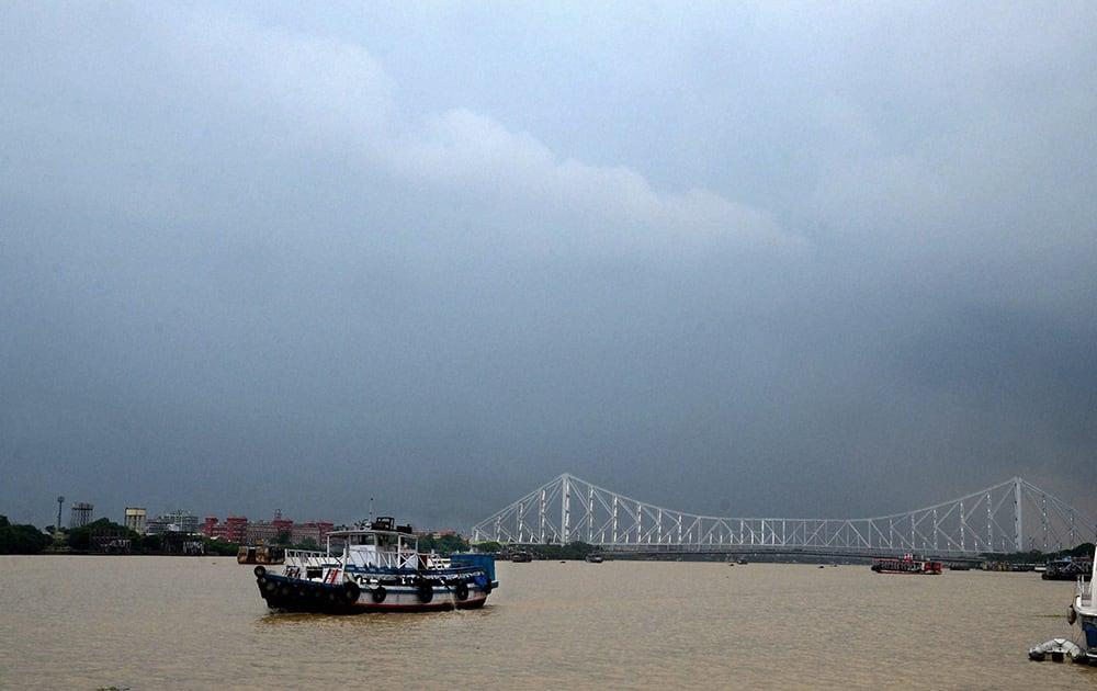 Dark clouds are seen in the sky over Howrah Bridge in Kolkata.