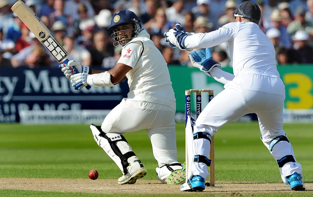 India`s Murali Vijay plays a shot past England wicket keeper Matt Prior, right, during day one of the first Test between England and India at Trent Bridge cricket ground, Nottingham, England.