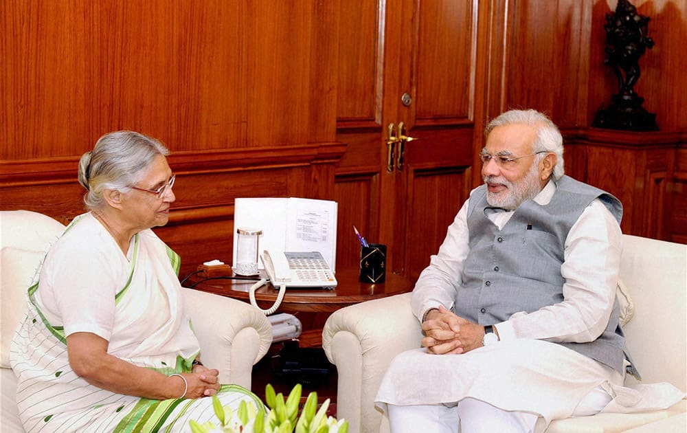 Prime Minister Narendra Modi and Governor of Kerala, Sheila Dikshit at a meeting in New Delhi.