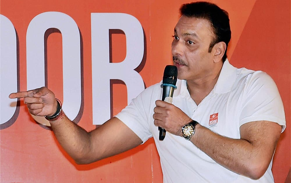 Former cricketer Ravi Shastri interacts with students at an event in Kolkata.