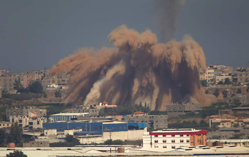 Smoke and debris rise after an Israeli strike on the Gaza Strip seen from the Israeli side of the Israel Gaza Border.