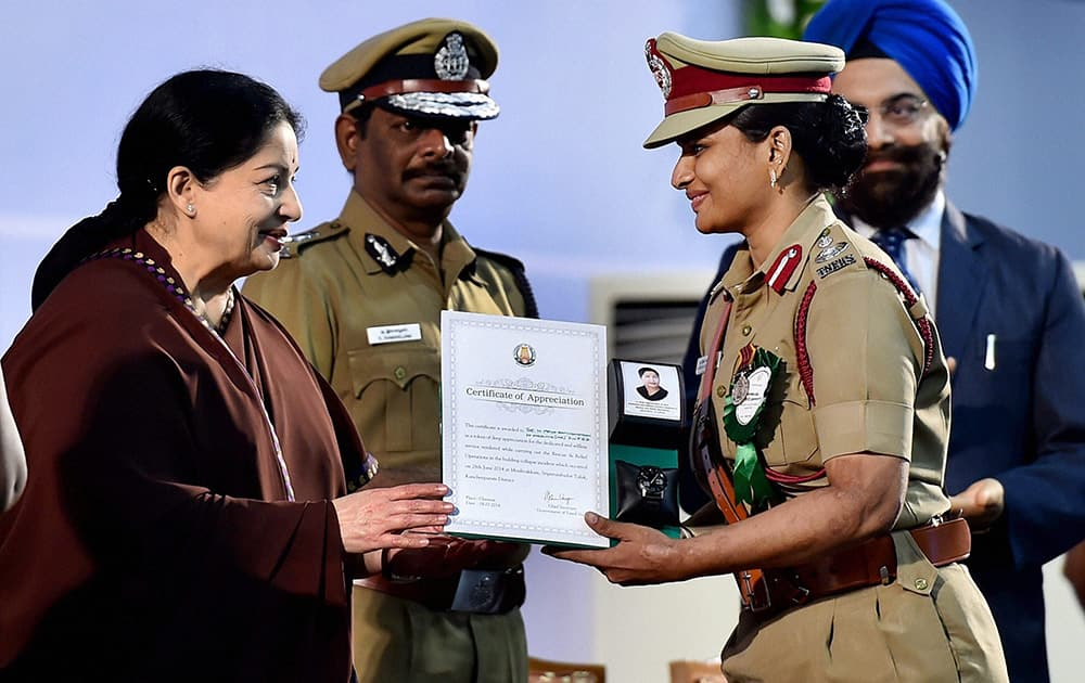 Tamil Nadu Chief Minister J Jayalalithaa honouring Divisional Fire Officer Priya Ravichandran of Tamil Nadu Fire and Rescue Services in a function in Chennai.