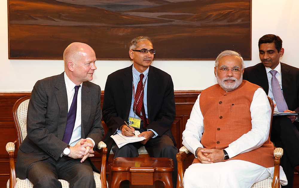 Indian Prime Minister Narendra Modi, right, sits with British Foreign Secretary William Hague during a meeting in New Delhi.