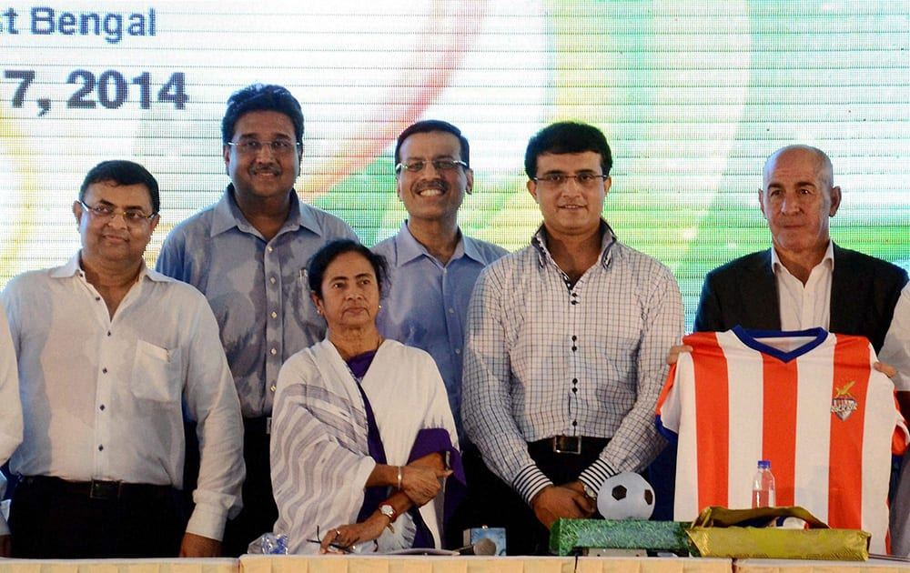 West Bengal Chief Minister Mamata Banerjee with former cricketer Sourav Ganguly, industrialist Sanjeev Goenka and other co-owners of Atletico de Kolkata during the unveiling of team`s jersey for the upcoming Indian Super League football tournament in Kolkata.