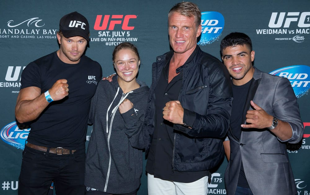 Kellan Lutz, left, Ronda Rousey, Dolph Lundgren and Victor Ortiz from this summer`s upcoming film The Expendables 3, pose for a photo just after UFC 175 at the Mandalay Bay Resort & Casino.