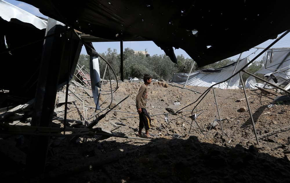 Palestinians inspect the rubble of a house after it was hit by an Israeli missile strike in Rafah, southern Gaza Strip.
