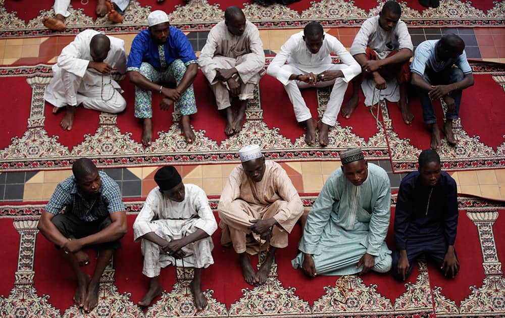 Nigerian Muslims offer prayers on the first Friday of Ramadan at the central Mosque in Lagos, Nigeria.