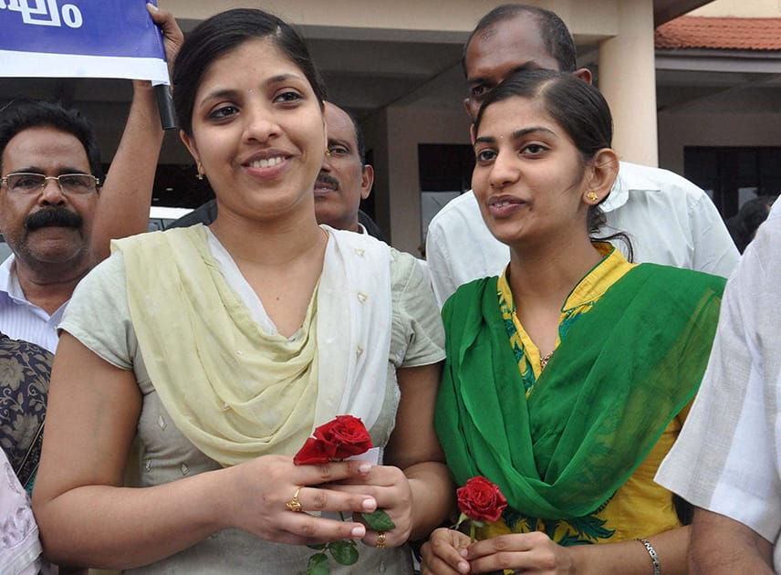 Two of the nurses who were stranded in the territory held by Islamic extremists in Iraq, upon arrival at the airport in Kochi.