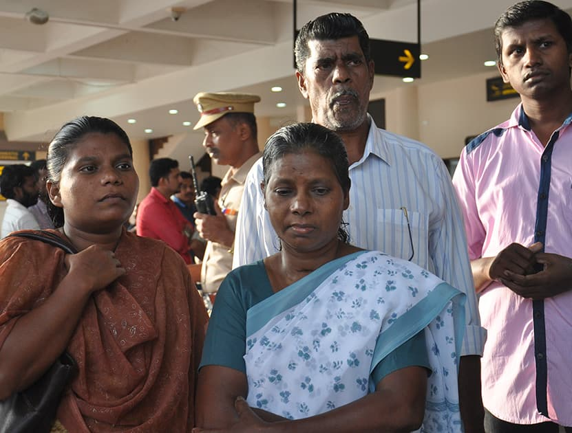 Family members of Indian nurses who had been stranded in territory held by Islamic militants in Iraq await their arrival at the airport in Kochi.