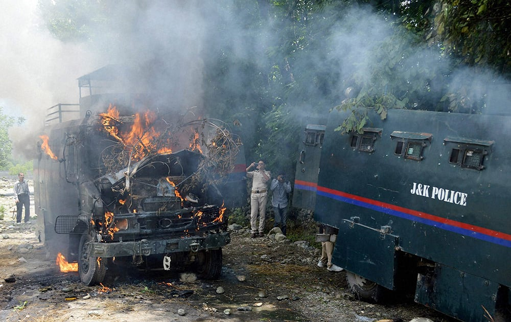 Protesters torch two police vehicles in Tral town.