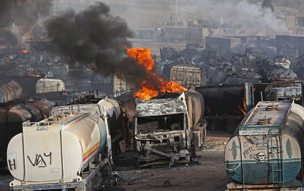 Flames rise from oil tankers after an attack claimed by Taliban militants on the outskirts of Kabul, Afghanistan.