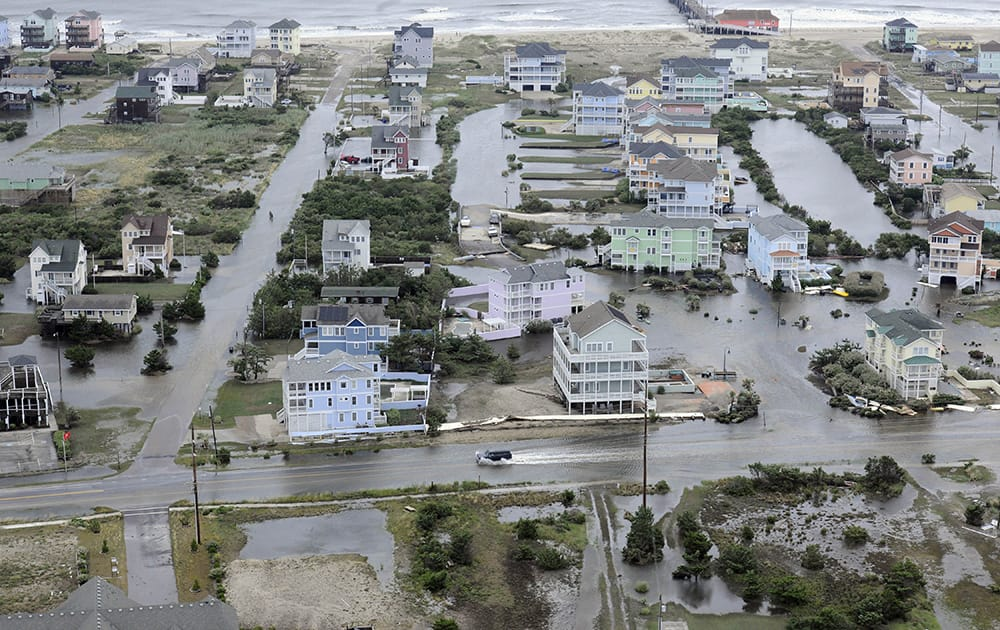 This photo provided by the US Coast Guard shows flooding caused by Hurricane Arthur on the Outer Banks of North Carolina.