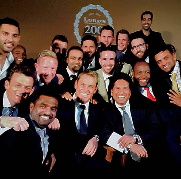 Cricket legend Sachin Tendulkar flanked by Brian Lara and Rahul Dravid on his left and Shane Warne and Muttiah Muralitharan on the right pose for the shutterbugs during a dinner party to celebrate bicentenary of Lord`s in London on Thursday. Also seen in the pciture are Yuvraj Singh, Virender Sehwag, Shahid Afridi, Adam Gilchrist and Kevin Pietersen.